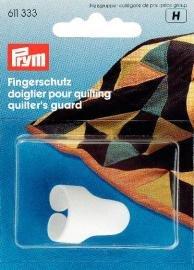 Justerbart fingerskydd för quilting